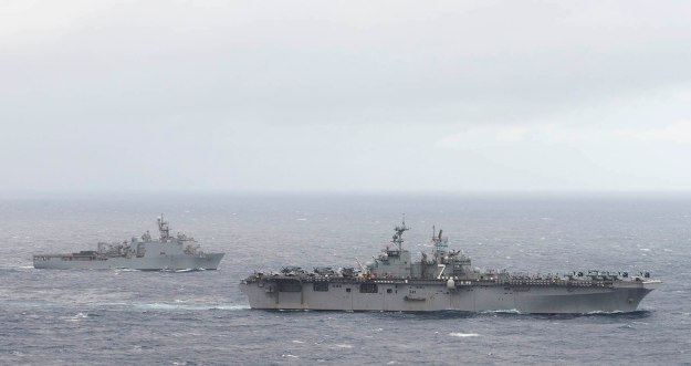 USS Iwo Jima (LHD-7) and the amphibious dock landing ship USS Fort McHenry (LSD-43) in the Atlantic Ocean on Dec. 21, 2014. US Navy Photo