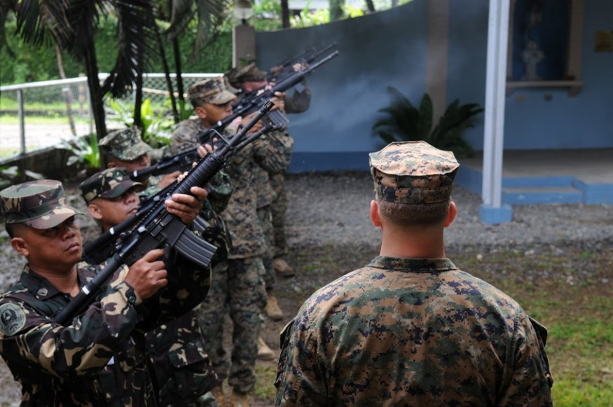 U.S. and Armed Forces of the Philippines (AFP) honor guard perform a 21-gun salute during a memorial service in Zamboanga City, Philippines in 2010. US Navy Photo