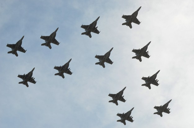 "The ""Gunslingers"" of Strike Fighter Squadron (VFA) 105 conduct a flyover during their homecoming at Naval Air Station Oceana, Va. on April 17, 2014. US Navy Photo"