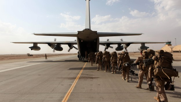 Marines and sailors with Marine Expeditionary Brigade – Afghanistan load onto a KC-130 aircraft on the Camp Bastion flightline on Oct. 27, 2014. US Marine Corps Photo