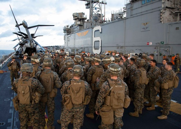 Marines assigned to the 31st Marine Expeditionary Unit (31st MEU) prepare for a live-fire exercise on the flight deck of the amphibious assault ship USS Bonhomme Richard (LHD-6) on Feb. 10, 2015. US Navy