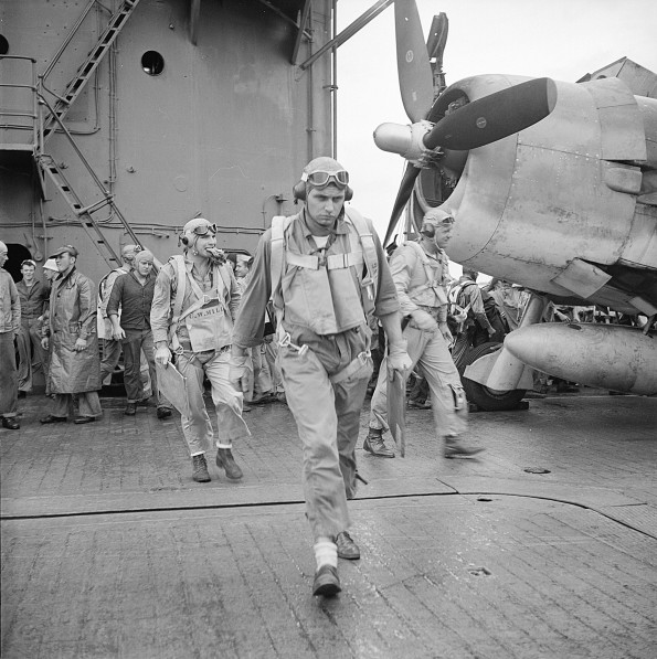 Pilots Ensign Charles Miller, Lieutenant (jg) Henry Dearing, and Lieutenant (jg) Bus Alber walking toward their aircraft aboard USS Saratoga, on Nov. 5, 1943. US Navy Photo via World War II Today