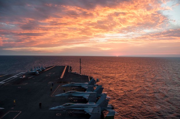 Aircraft sit on the flight deck of the aircraft carrier USS Theodore Roosevelt (CVN-71) on Oct. 29, 2014. US Navy Photo