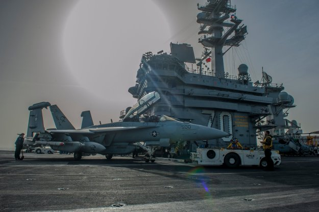 an EA-18G Growler from the Cougars of Electronic Attack Squadron (VAQ) 139 on the flight deck of the Nimitz-class aircraft carrier USS Carl Vinson (CVN 70).