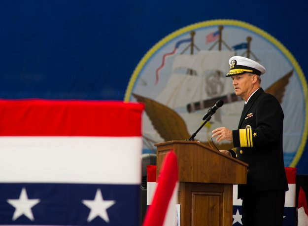 Vice Adm. Robert Thomas, commander of U.S. 7th Fleet, delivers remarks during a change of command ceremony aboard the Nimitz-class aircraft carrier USS George Washington (CVN-73). US Navy Photo