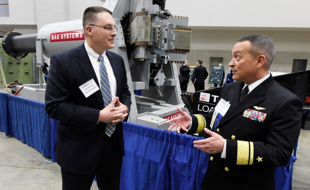 Ben McGlasson, a mechanical engineer for the Naval Surface Warfare Center Dahlgren Division, talks with Rear Adm. Mat Winter, chief of naval research on Feb. 4, 2015. US Navy Photo