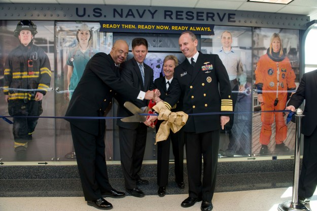 Chief of Naval Operations (CNO) Adm. Jonathan Greenert, Chief of Navy Reserve Vice Adm. Robin Braun, Assistant Secretary of the Navy for Manpower and Reserve Affairs Juan Garcia and Navy Reserve Force Master Chief C.J. Mitchell cut a ribbon in front of the new Centennial of the U.S. Navy Reserve display in the Pentagon on March 2, 2015. US Navy Photo