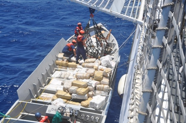 Coast Guardsmen from the Coast Guard Cutter Stratton from Alameda, Calif., unload narcotics from a smuggling vessel intercepted by the crew in the Eastern Pacific Ocean July 30, 2014. US Coast Guard Photo
