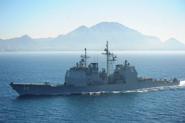 The Ticonderoga-class guided-missile cruiser USS Vicksburg (CG 69) transits the Strait of Gibraltar on March 31, 2015, as part of the Theodore Roosevelt Carrier Strike Group. US Navy photo.