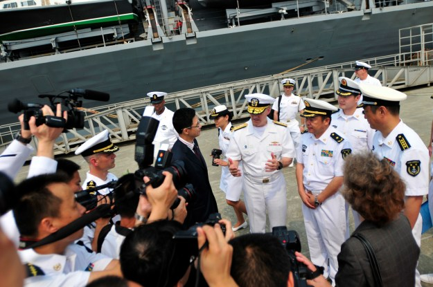 Chinese media document the arrival of Vice Adm. Robert Thomas, commander of U.S. 7th Fleet, during a welcome ceremony in Zhanjiang following the arrival of the U.S. 7th Fleet flagship USS Blue Ridge (LCC 19) on April 20, 2015. US Navy photo.