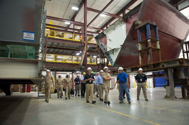Chief of Naval Operations (CNO) Adm. Jonathan Greenert tours the Marinette Marine Corporation shipyard to view the construction progress of multiple Freedom-class variants of the littoral combat ship (LCS) in various stages of completion in July 2013. US Navy photo.