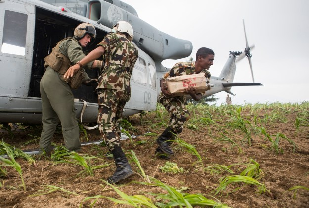 Nepalese army soldiers unload aid and relief supplies, delivered by Joint Task Force 505, from a UH-1Y Venom in the Kavrepalanchowk District, Nepal, May, 11, during Operation Sahayogi Haat. That aircraft went missing on May 12. US Marine Corps photo.