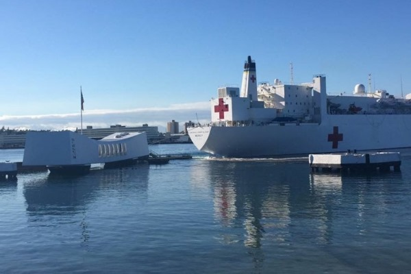 A photo of USNS Mercy near the USS Arizona Memorial in Hawaii shortly after a tug pushing the ship may have struck the iconic white pavilion. Photo courtesy Military.com.