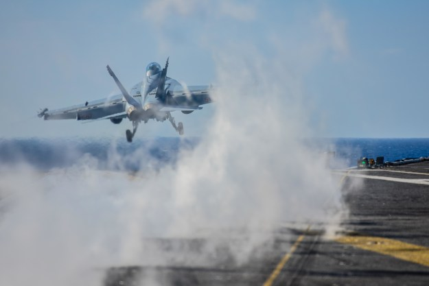 An E/A-18G Growler attached to the Wizards of Electronic Attack Squadron (VAQ) 133 launches from the flight deck of the aircraft carrier USS John C. Stennis (CVN 74) on April 20, 2015. US Navy photo.