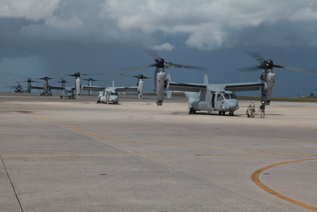U.S. Marine Corps pilots and crew of MV-22B Osprey with Marine Medium Helicopter Squadron 262 (HMM-262),at Marine Corps Air Station Futenma (MCAS Futenma), Aug. 12, 2013. US Marine Corps photo.