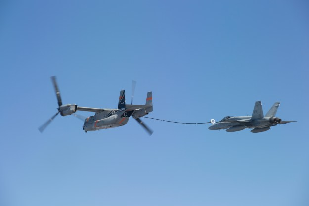 The Bell Boeing V-22 Program successfully completed an initial test of the V-22 Osprey performing as an aerial refueling tanker. In the August demonstration over north Texas, a V-22 equipped with a prototype aerial refueling system safely deployed, held stable, and retracted the refueling drogue as an F/A-18 Hornet flew just behind and to the side of the aircraft. Bell Boeing photo.