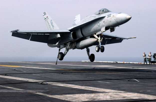 "An F/A-18C Hornet assigned to the ""Gladiators"" of Strike Fighter Squadron 106 (VFA-106) makes an arrested landing aboard USS Theodore Roosevelt in 2006. US Navy Photo"