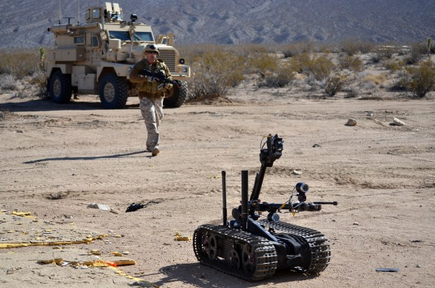"""Reserve component Sailors assigned to Explosive Ordnance Disposal Operational Support Unit 7 use a Man Transportable Robot System """"Talon"""" Mark 2 to approach a suspected bomb maker's building during a mobility exercise at Naval Air Weapons Station China Lake in March 2012. AEODRS Increment 2 is meant to replace this system. US Navy photo."""