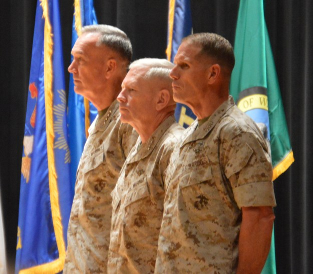 Lt. Gen. Robert Walsh (right) takes command of the Marine Corps Combat Development Command from retiring Lt. Gen. Kenneth Glueck (center) in an Aug. 20 ceremony at Marine Corps Base Quantico, Va. USNI News photo.