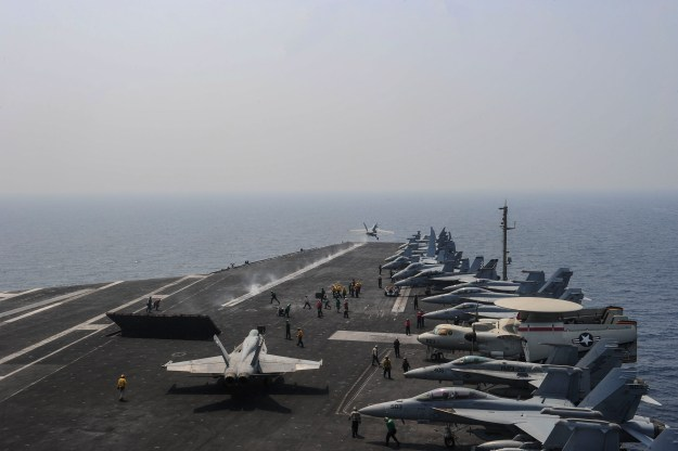 An F/A-18F Super Hornet assigned to the Checkmates of Strike Fighter Squadron (VFA) 211 launches from the flight deck aboard the aircraft carrier USS Theodore Roosevelt (CVN 71) on Aug. 20, 2015. US Navy photo.