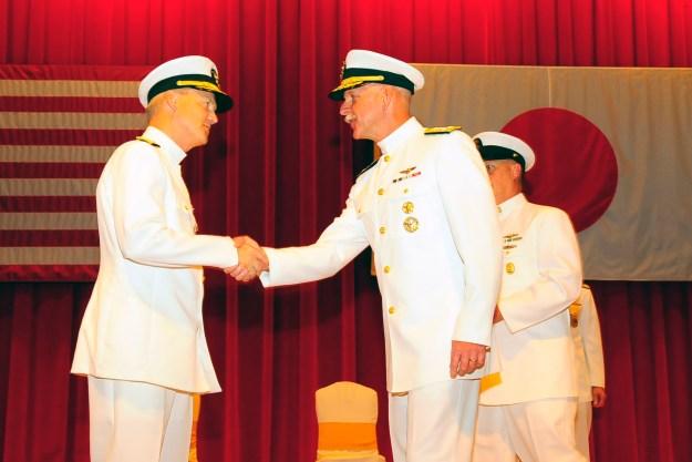 Adm. Scott H. Swift, commander, U.S. Pacific Fleet, congratulates Vice Adm. Robert L. Thomas, commander U.S. 7th Fleet, during a change of command ceremony at Fleet Activities Yokosuka Fleet Theater on Sept. 7, 2015. US Navy photo.