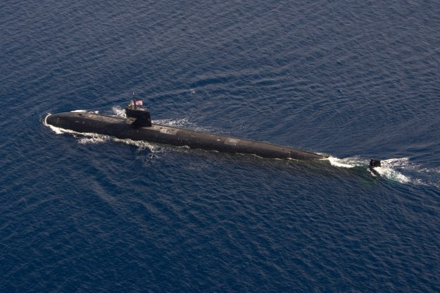 The Los Angeles-class attack submarine USS City of Corpus Christi (SSN 705) transits into formation during a photo exercise as a part of Exercise Malabar 2015 on Oct. 16, 2015. US Navy photo.