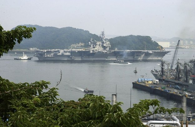 The former USS Kitty Hawk (CV-63) gets underway from its homeport at Yokosuka Naval Base, Japan in 2004. US Navy Photo
