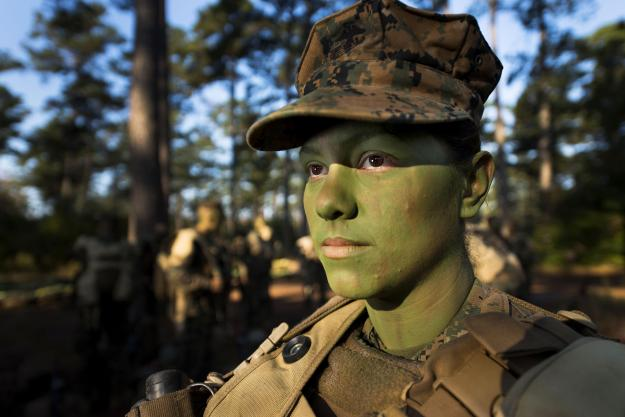 Pfc. Christina Fuentes Montenegro prepares to hike to her platoon's defensive position during patrol week of Infantry Training Battalion near Camp Geiger, N.C. on Oct. 31, 2013. US Marine Corps Photo