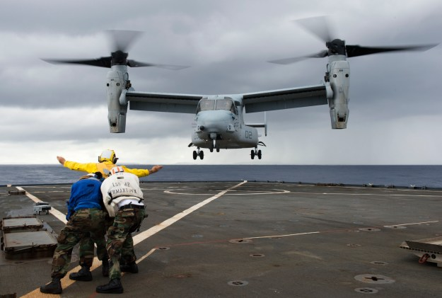 Sailors direct an MV-22 Osprey assigned to Marine Medium Tiltrotor Squadron (VMM) 265 as it lands on the flight deck of the amphibious dock landing ship USS Germantown (LSD 42) during exercise Blue Chromite off Okinawa in November 2014. US Navy photo.