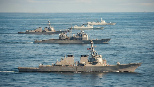 The Chinese Luyang II-class guided missile destroyer Jinan (DDG 152), top, the Jiangkai-class frigate Yiyang (FFG 548), the Arleigh Burke-class guided missile destroyer USS Mason (DDG 87), center, the Ticonderoga-class guided missile cruiser USS Monterey (CG 61) and the Arleigh Burke-class guided missile destroyer USS Stout (DDG 55), bottom, steam in formation during a passing exercise on Nov. 7, 2015, in the Atlantic Ocean. US Navy photo.