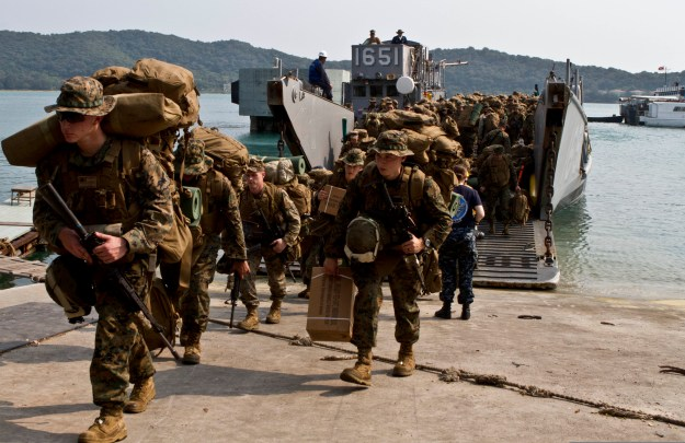Sailors and Marines with the 31st Marine Expeditionary Unit step off Landing Craft Utility (LCU) 165 at Koh Phangan, Thailand in 2013. US Marine Corps Photo