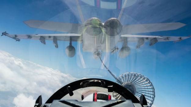 An F/A-18E Super Hornet assigned to the Warhawks of Strike Fighter Squadron (VFA) 97 prepares to refuel an EA-18G Growler assigned to the Wizards Electronic Attack Squadron (VAQ) 133 on Feb. 11, 2016. US Navy photo.