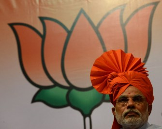 Modi seems set for national role, tears into Congress