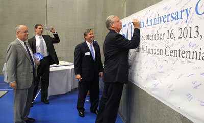 "MISSOURI GOV. JEREMIAH ""Jay"" Nixon, right, signs a commemorative banner for Missouri State University-West Plains' 50th anniversary celebration Monday.  The banner will be placed inside a time capsule that will be displayed on campus until its opening 50 years from now.  Looking on are, from left, Missouri State University System President Clif Smart, a member of Nixon's staff, and Missouri State-West Plains Chancellor Drew Bennett.  (Missouri State-West Plains Photo)"