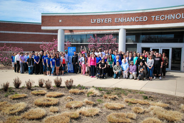 "APPROXIMATELY 250 students, faculty, staff and community members gathered in front of Lybyer Technology Center at Missouri State University-West Plains Thursday afternoon to celebrate the donation of more than 50,000 hours of community service as part of the Operation 50K initiative.  The year-long initiative, begun following 2013 commencement ceremonies, was designed to commemorate the campus' 50th anniversary while celebrating its public affairs mission.  ""We believe serving our communities is a great way to say thanks,"" Chancellor Drew Bennett said at the announcement.  As of Thursday afternoon, over 51,000 hours had been recorded.  Bennett encouraged everyone to continue reporting their hours online on the Operation 50K website until the May 17 deadline.  A final tally will be announced that day at commencement, he said.  (Missouri State-West Plains Photo)"