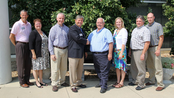 "OFFICIALS WITH MISSOURI STATE University-West Plains, the South Central Workforce Investment Board (SCWIB) and the Missouri Career Center in West Plains celebrate the inking of a ""memorandum of understanding"" between the university and SCWIB to provide training for health information technology and agri-business careers to qualified job seekers through the Rural Revitalization and Recovery Project made possible with a $2.5 million grant from the U.S. Department of Labor's Trade Adjustment Assistance Community College and Career Training (TAACCCT) grant program.  From left are Missouri State-West Plains Director of Business and Support Services Scott Schneider, TAACCCT Grant Project Manager Sheila Barton, Interim Dean of Academic Affairs Dennis Lancaster, Chancellor Drew Bennett, SCWIB Chairman Garland Barton, SCWIB Executive Director Melissa Robbins, Missouri Career Center Skills Coordinator Scott Davis and Workforce Development Supervisor Kyle Mahan.  (Missouri State-West Plains Photo)"