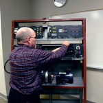 JIM HART, assistant professor of computer information systems at Missouri State-West Plains, inspects equipment that will be used to train students at the new Greater Ozarks Center for Advanced Technology (GOCAT) in West Plains. GOCAT is a partnership between Missouri State University-West Plains, the South Central Career Center and the City of West Plains. (Photo provided)