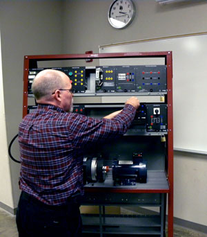 Assistant Professor Jim Hart demonstrates the use of some of the advanced technology equipment.