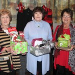 "FOUR WEST PLAINS RESIDENTS won giveaways at the ""Razzle Dazzle"" fashion show Friday, Nov. 4, at the West Plains Country Club. Beverly Linson received a childen's Christmas variety pack from Cleea's At Home Market, Vicky Combs won a Brighton Christmas ornament from The Kloz Klozet, and Pam Smith received a beer bread mix and Christmas plates from Cleea's At Home Market. Dottie Summers was the grand prize giveaway winner and received a Brighton notepad and coin purse and a Crabtree & Evelyn travel pack from The Kloz Klozet and a $25 gift certificate from Cleea's At Home Market. The annual event, hosted by The Kloz Klozet and Cleea's At Home Market and sponsored by Friends of the Garnett Library, raises funds to support library needs. From left are Linson, Summers and Smith. (Missouri State-West Plains Photo)"