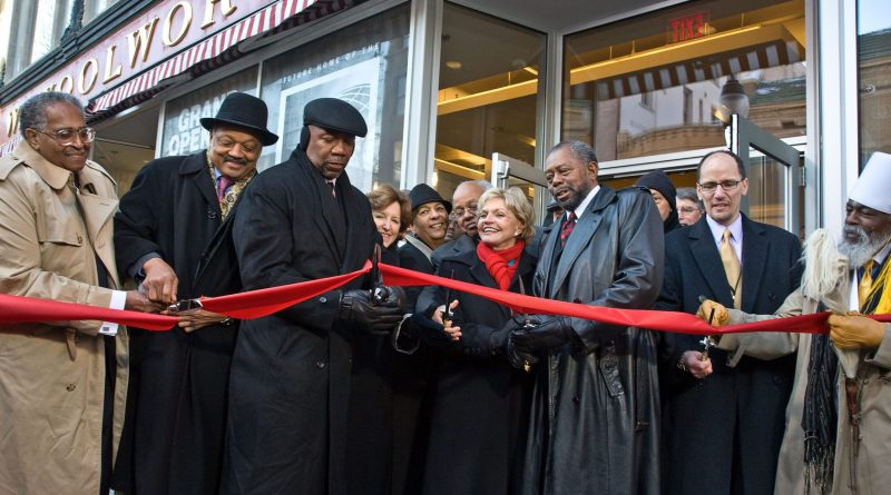 Civil rights leaders, including the Rev. Jesse Jackson, celebrate the opening of the International Civil Rights Center & Museum last year./PRNewswire