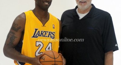 Happier Times: Kobe Bryant and Phil Jackson at the Los Angeles Lakers Media Day last fall. The Lakers defeat to Dallas Mavericks could mean the end for the tandem./Dennis J. Freeman