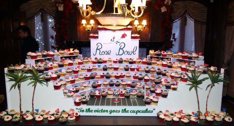 "A full ""Nadia Cakes"" display fit for a king. Nadia Cakes and owner Abby Jimenez were the winners of the Food Network's ""Cupcake Wars."" Photo Credit: Daniel Photography/Nadia Cakes"