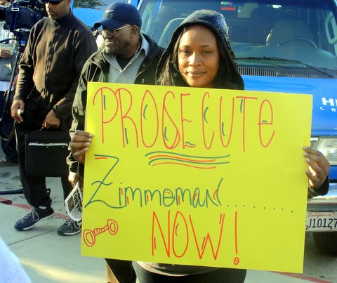 A Los Angeles woman attends rally condemning the shooting death of Trayvon Martin. Photo: Dennis J. Freeman