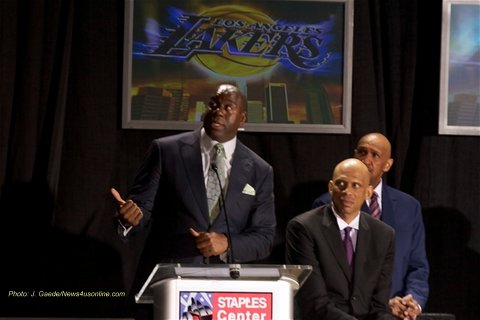 "Earvin ""Magic"" Johnson leads the celebration of the statue unveiling for Kareem Abdul Jabbar in front of the famed Staples Center in Los Angeles. Photo Credit: J. Gaede"