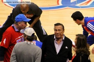 LA Clippers owner Donald Sterling (center) is at the center of a race firestorm.