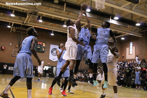 Players from No Shnacks and Sole Clinics battle at the rim during a Drew League game on Sunday, July 27. Photo Credit: Dennis J. Freeman/News4usonline.com
