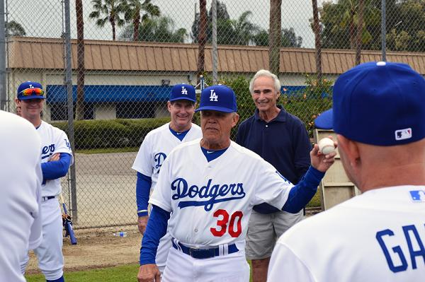 Steve Garvey and Sandy Koufax observe Maury Wills offering instruction at Dodgers Adult Baseball Camp Monday at Historic Dodgertown in Vero Beach, Fla.