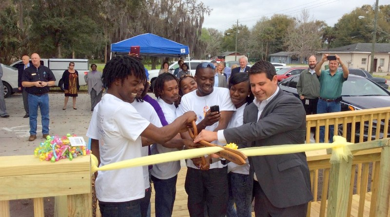 Kamarre Anders, a student in the center's first graduating class, joined his classmates Shon'Tavia Cooper, Antwan Johnson-Tobler, Lucious Jackson, Donell Johnson and Azurnisha Ulysse in helping state Representative Travis Hutson cut the ceremonial ribbon at the center Tuesday. (PRNewsFoto/The Florida Endowment Foundation)
