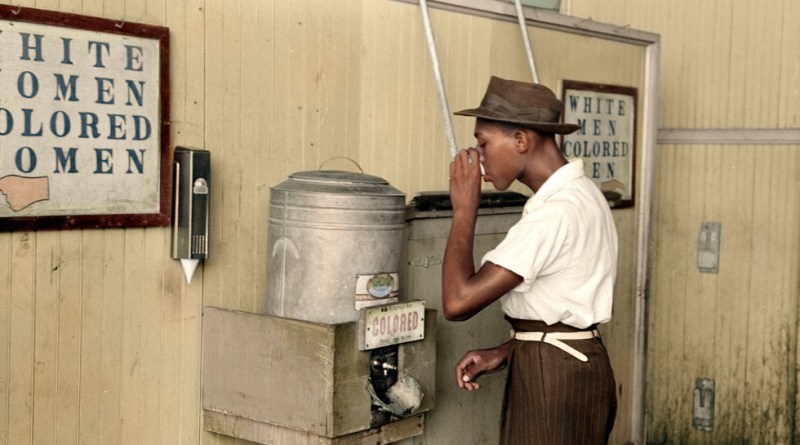 "photo credit: ""Negro drinking at 'Colored' water cooler in streetcar terminal, Oklahoma City, Oklahoma"" ca. July 1939 via photopin (license)"
