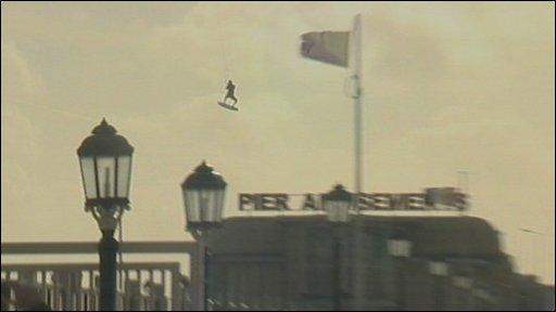 Kite surfer jumping over Worthing pier